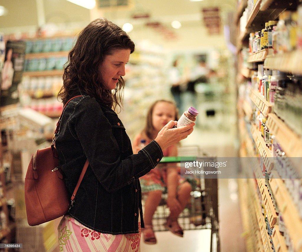 Woman choosing vitamins : Stock Photo