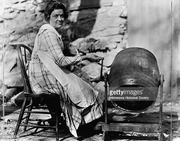 Woman Churning Butter in a Barrel Churn