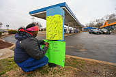 A woman claiming to be the girlfriend of 18 yearold Antonio Martin leaves a message on a makeshift memorial outside the Mobil on the Run gas station...