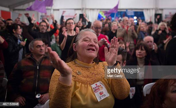 A woman claps her hands as supporters of Syriza react as exit polls show their party is set to win the election on January 25 2015 in Athens Greece...
