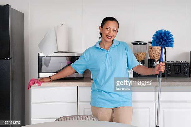 Woman Cleaning a Corporate Break Room