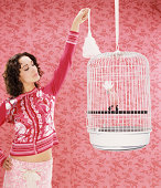 Woman Cleaning Bird Cage