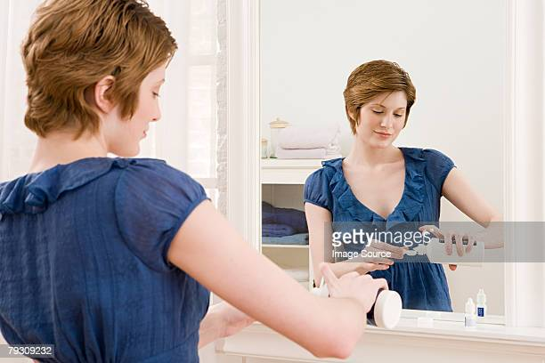 A woman cleaning contact lenses