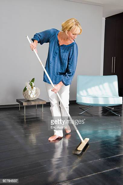 Woman cleaning floor with a mop