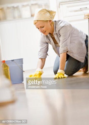 Woman cleaning Kitchen Floor : Stock Photo