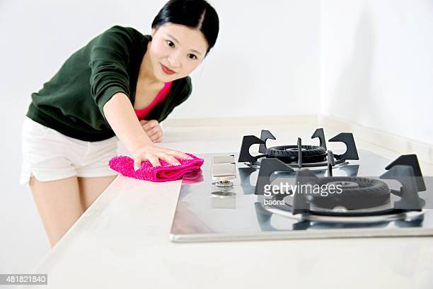Woman cleaning the kitchen