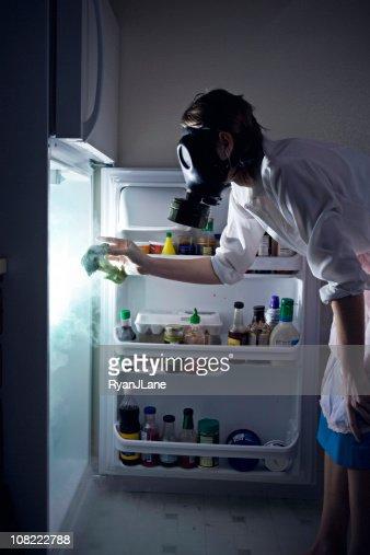 Woman Cleaning Toxic Waste Glowing Fridge