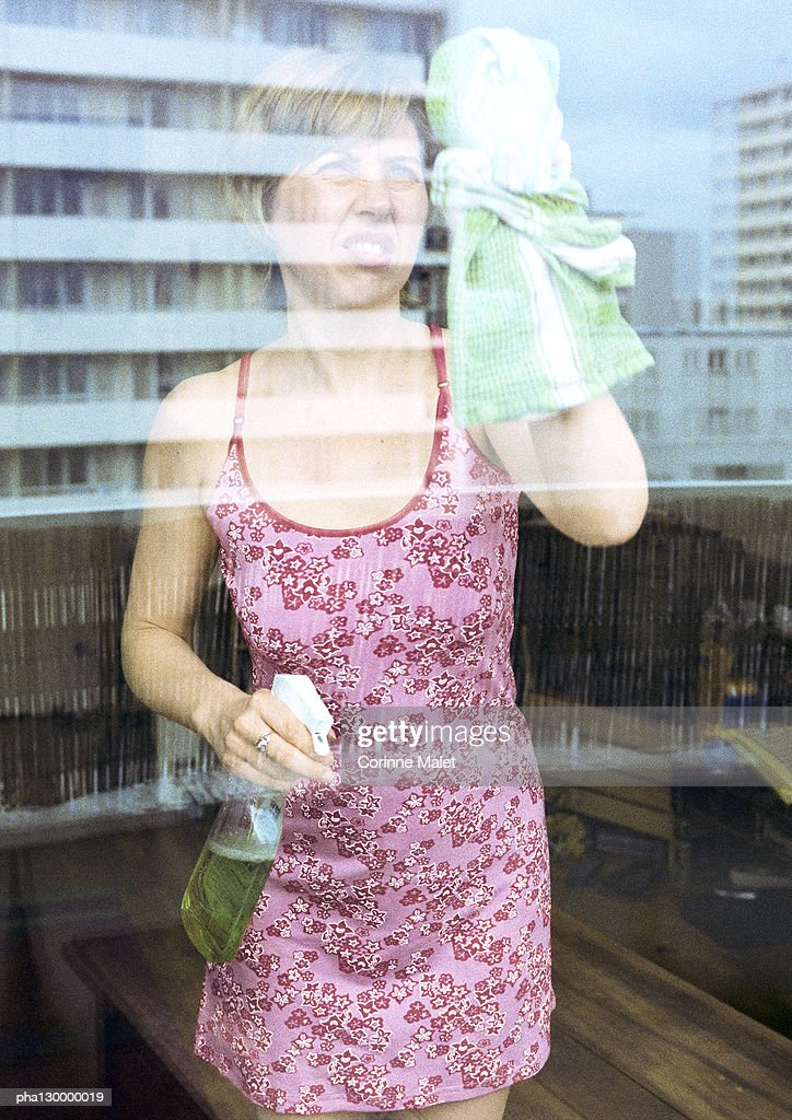 Woman cleaning window. : Stock Photo