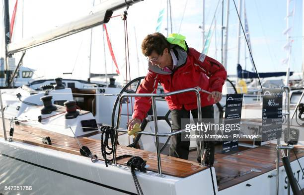 A woman cleans an Arcona 465 Carbon yacht with a price tag of Acircpound451417 at the Southampton Boat Show which runs until September 24th at...