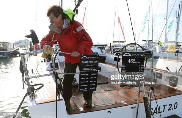 A woman cleans an Arcona 465 Carbon yacht with a price tag of pound451417 at the Southampton Boat Show which runs until September 24th at Mayflower...