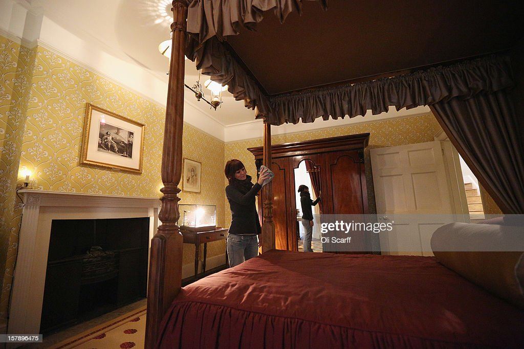 A woman cleans Charles Dickens' bedroom inside the Charles Dickens Museum on December 7, 2012 in London, England. The museum will re-open to the public on December 10, 2012 following a major 3.1 million GBP refurbishment and expansion programme to celebrate Dickens' bicentenary year. The museum is located in Charles Dickens' house on Doughty Street where he lived from 1837 until 1839 and in which he wrote many novels including Oliver Twist and Nicholas Nickleby.