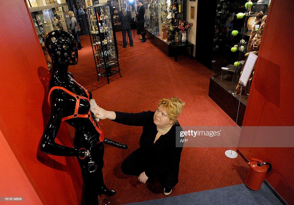 A woman cleans oone of the displays at the 'MuzEros', an erotic museum, shortly after its opening in Russia's second city of St. Petersburg on February 13, 2013. The museum exhibits a collection of sexual artifacts from around the world, the museum organizers said.