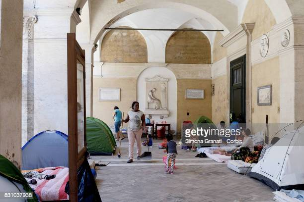 A woman cleans the Colonnade of the Basilica where she lives with other families since August 11 after leaving the occupied palace in Quintavalle...