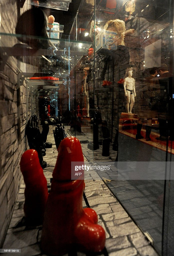 A woman cleans the window of one of the displays at the 'MuzEros', an erotic museum, shortly after its opening in Russia's second city of St. Petersburg on February 13, 2013. The museum exhibits a collection of sexual artifacts from around the world, the museum organizers said.