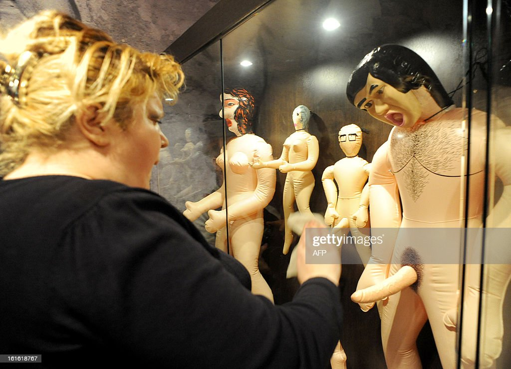 A woman cleans the window one of the displays at the 'MuzEros', an erotic museum, shortly after its opening in Russia's second city of St. Petersburg on February 13, 2013. The museum exhibits a collection of sexual artifacts from around the world, the museum organizers said.