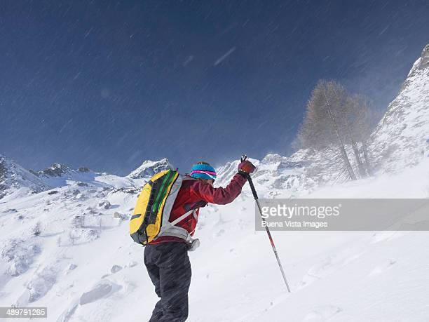 Woman climbing a snowy mountain