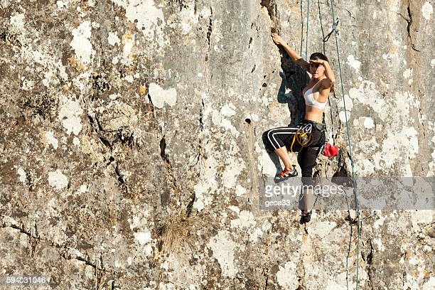 Woman climbing the mountain