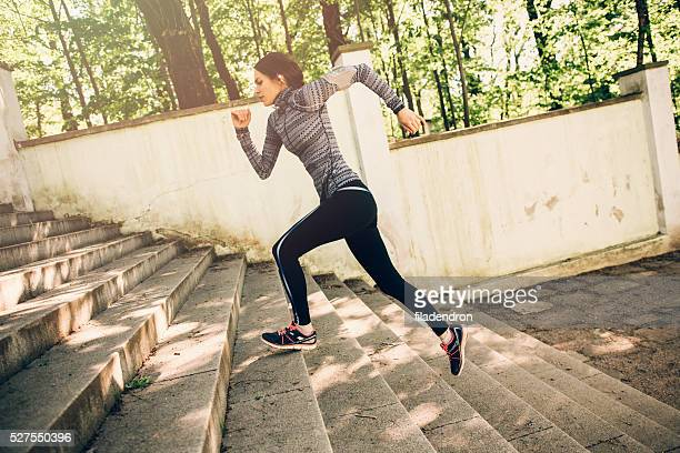 Woman Climbing Up The Stairs