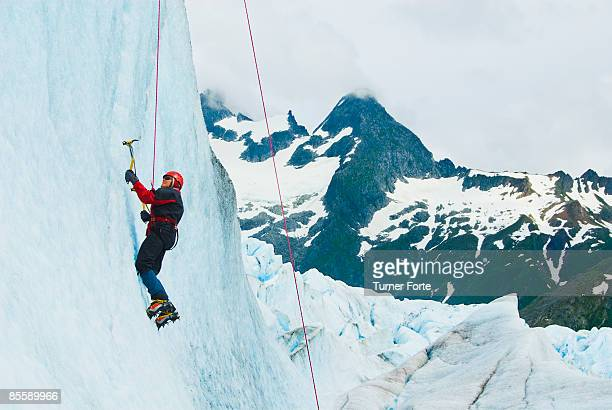 Woman climbs glacial cliff