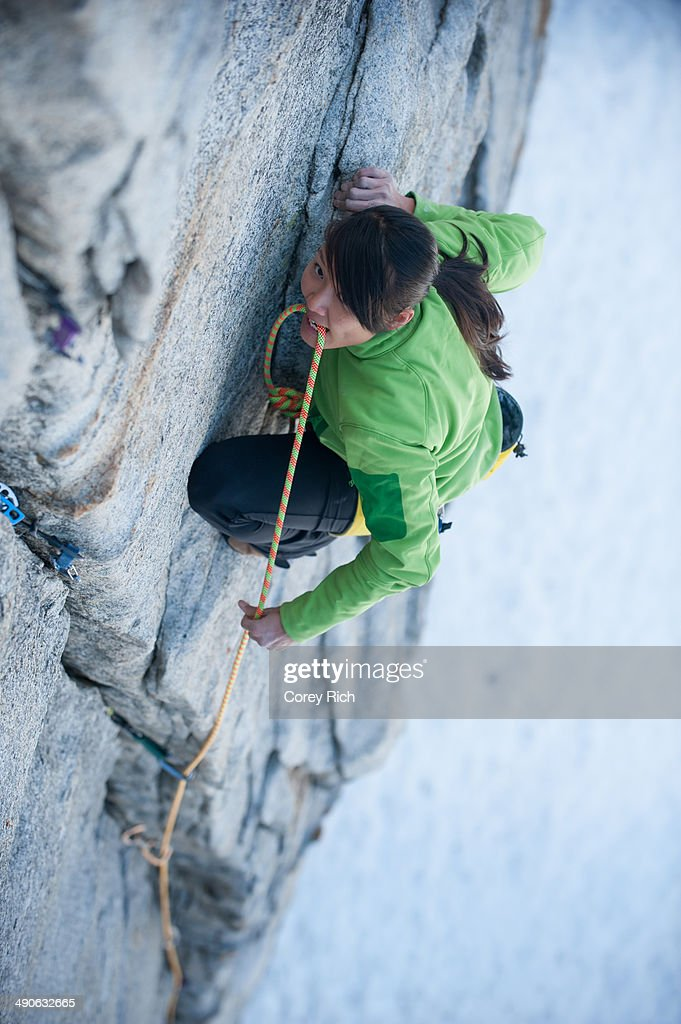 A woman climbs The Line (5.9) at Lover's Leap in Lake Tahoe, California.