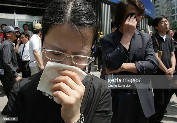 A woman closes her eyes during the public funeral of former South Korean president Roh MooHyun on May 29 2009 in Seoul South Korea Roh jumped to his...