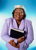 Woman clutching bible