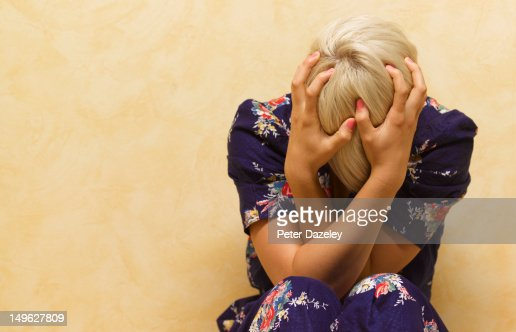 Woman clutching her head in mental anguish : Stock Photo