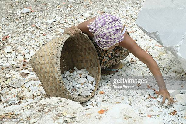 A woman collecting marble waste in Sagyin village on 19th May 2016 in Mandalay division Myanmar Sagyin a village 21 miles north of Mandalay is known...