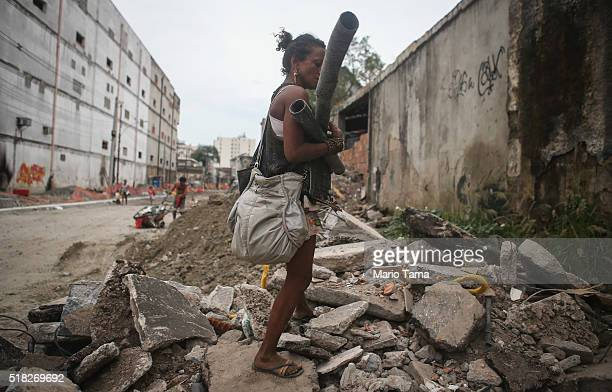 A woman collects items to recycle along a demolished street still under reconstruction in the Port Zone part of the Marvelous Port project on March...