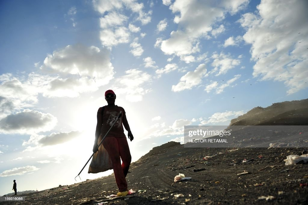A woman collects plastics and metals to be sold for recycling, at Managua's landfill 'La Chureca', on January 10, 2013. AFP PHOTO/Hector RETAMAL
