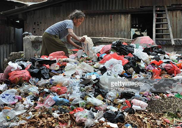 A woman collects used plastic bags from a garbage dump for resale in Jakarta on February 16 2011 The head of the World Bank Robert Zoellick raised...