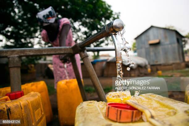 A woman collects water from a water point in Juba South Sudan on March 21 2017 International World Water Day is marked annually on March 22 to focus...