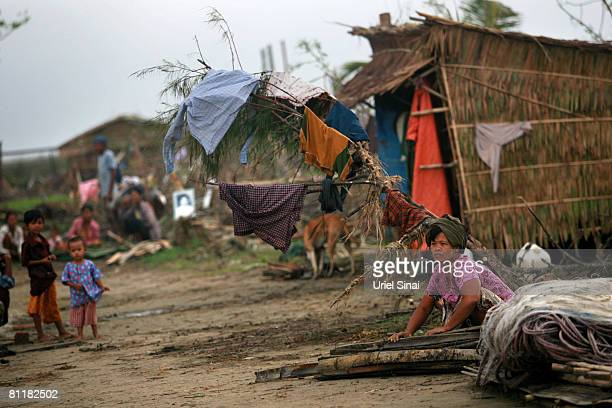 A woman collects wood at the isolated village of Myasein Kan on May 20 2008 in the Ayeyarwaddy delta Myanmar It has been estimated that more than...
