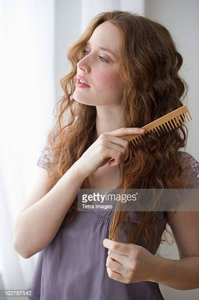 Woman combing her hair