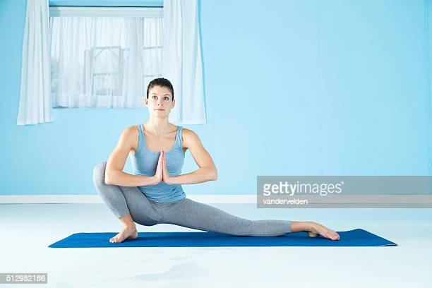 Woman Combining Yoga And Gymnastics