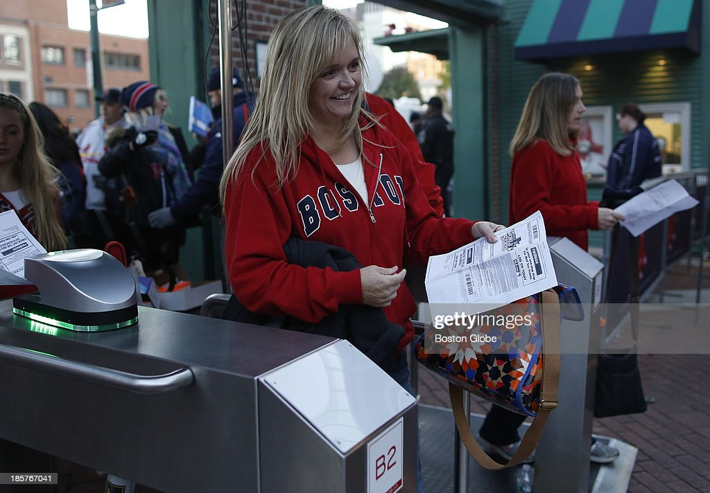 A woman comes through the turnstile as she enters Game Two of the 2013 Major League Baseball World Series between the St. Louis Cardinals and Boston Red Sox at Fenway Park, Oct. 24, 2013.