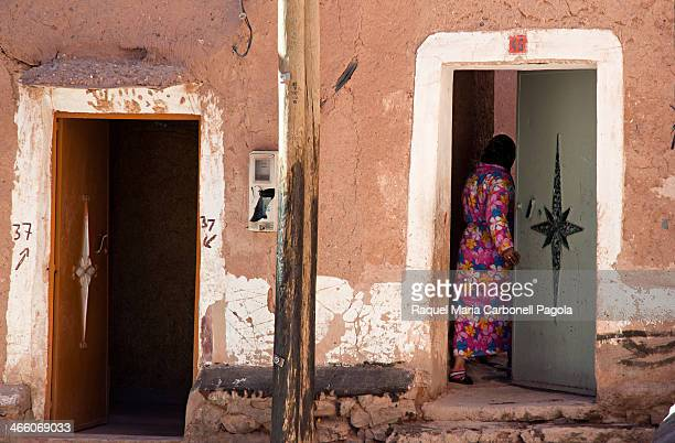 Woman coming in her house in the mellah