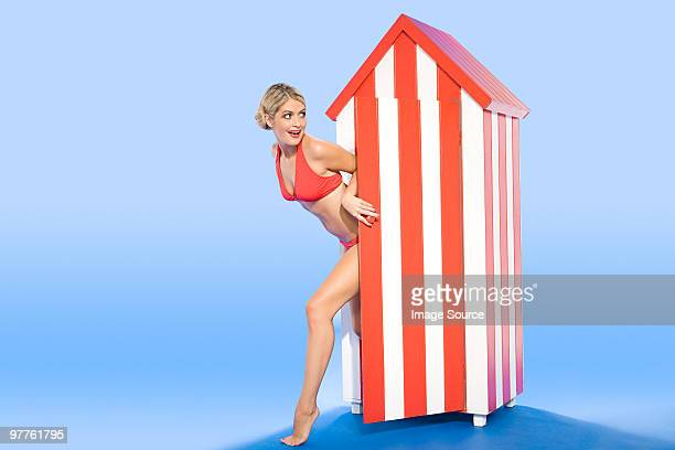 Woman coming out of beach hut