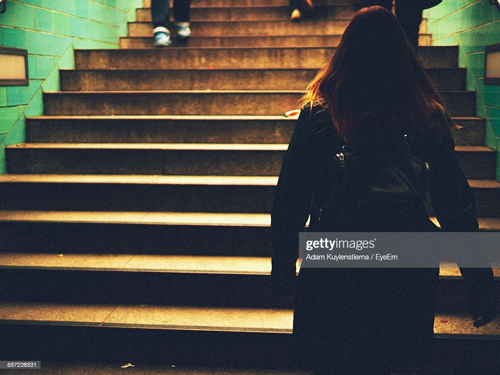 Woman Coming Out Of Subway Station