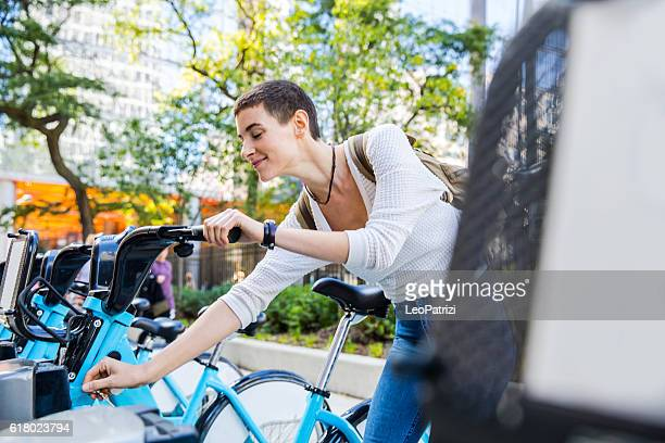 Woman commuting to work by bicycle in the city