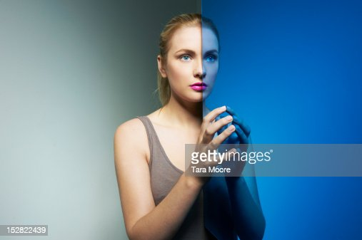 woman connecting hands in mirror : Stock Photo