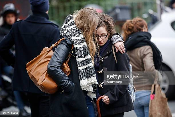 A woman consoles a mourner outside at the Cafe Bonne Biere restaurant the site of one of Friday's terror attacks in Paris France on Monday Nov 16...