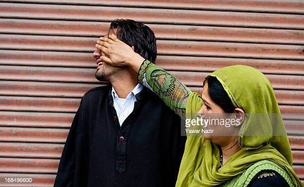 A woman consoles a relative of Farooq Ahmad an Indian police officer who was killed by suspected militants grieve during his funeral on May 10 2013...