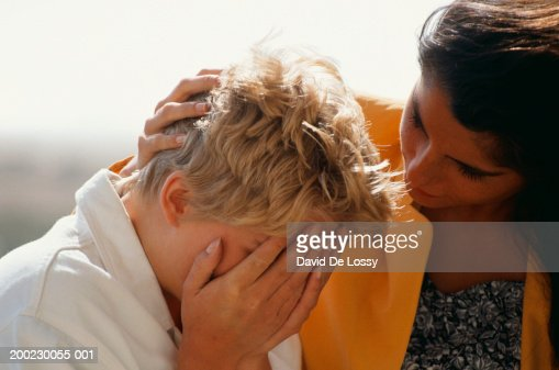 Woman consoling distressed friend, outdoors : Stock Photo
