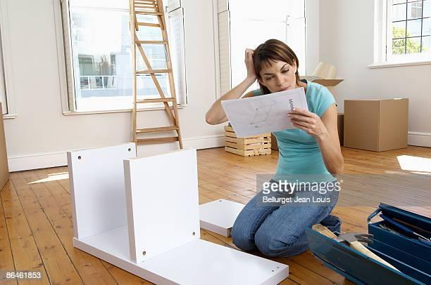 Woman constructing shelf