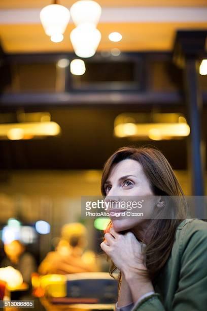 Woman contemplating, portrait