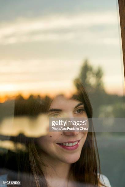 Woman contemplating private future while watching sunrise