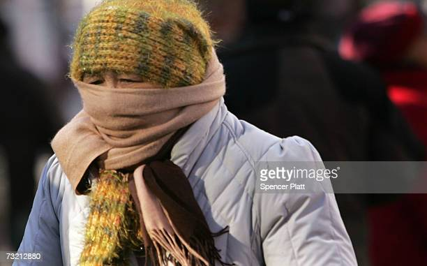 A woman contends with bitterly cold weather February 5 2007 in New York City After an unusually mild December and January New York and the northeast...
