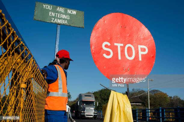 A woman controls the traffic between Zambia and Zimbabwe A STOP sign indicates that we are entering Zambia Today one of the Victoria Falls Bridge's...