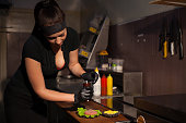 woman Cook prepares a burger in the kitchen nice